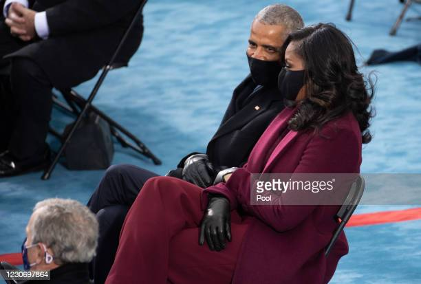 Former US President Barack Obama and Former US First Lady Michelle Obama attend the 59th Presidential Inauguration at the U.S. Capitol on January 20,...