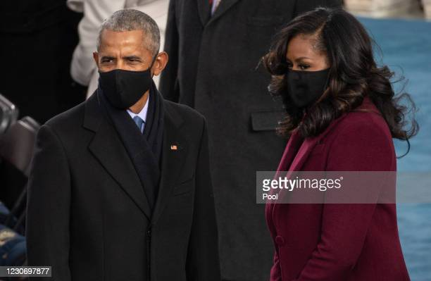 Former US President Barack Obama and Former US First Lady Michelle Obama arrive to the 59th Presidential Inauguration at the U.S. Capitol on January...