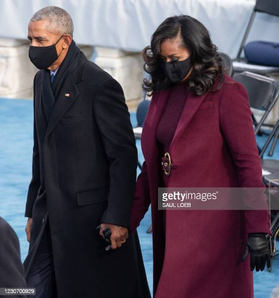 Former US President Barack Obama and Former US First Lady Michelle Obama arrive for the 59th Presidential Inauguration on January 20 at the US...