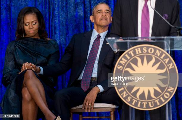 TOPSHOT Former US President Barack Obama and former US First Lady Michelle Obama attend the unveiling of their portraits at the Smithsonian's...