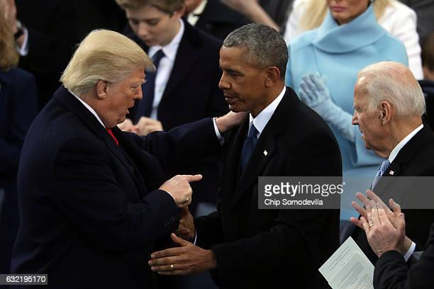 Former US President Barack Obama and former Vice President Joe Biden congratulate US President Donald Trump after he took the oath of office on the...