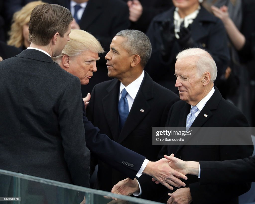 Former U.S. President Barack Obama (C) and former Vice President Joe Biden (R) congratulate U.S. President Donald Trump after he took the oath of office on the West Front of the U.S. Capitol on January 20, 2017 in Washington, DC. In today's inauguration ceremony Donald J. Trump becomes the 45th president of the United States.