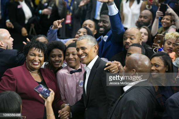 Former US President Barack Obama and Georgia Democratic Gubernatorial candidate Stacey Abrams pose for a photo during a campaign rally at Morehouse...