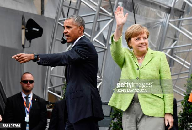 Former US president Barack Obama and German Chancellor Angela Merkel leave the stage after their panel discussion during the Protestant church day...