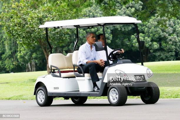 Former US President Barack Obama and Indonesian President Joko Widodo drive a golf cart as they leave Bogor Presidential Palace in Bogor West Java of...