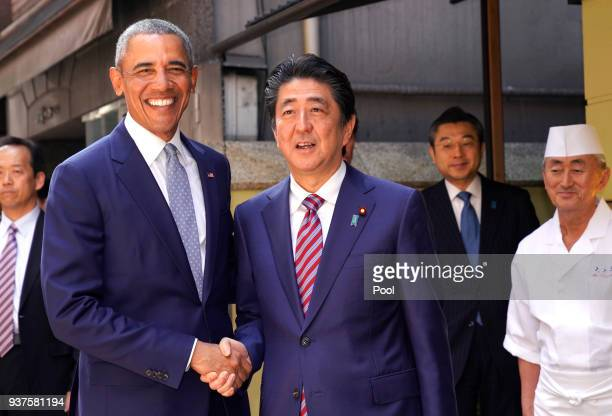 Former US President Barack Obama and Japanese Prime Minister Shinzo Abe pose for photographers in front of Japanese Sushi restaurant in Tokyo's Ginza...