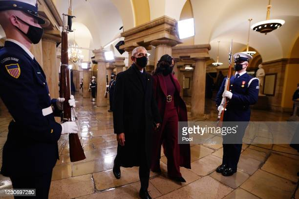 Former US President Barack Obama and Michelle Obama arrive in the Crypt of the US Capitol for President-elect Joe Biden's inauguration ceremony to be...