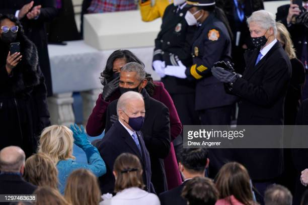 Former U.S. President Barack Obama and Michelle Obama greet President-elect Joe Biden and Dr. Jill Biden as former U.S. President Bill Clinton and...