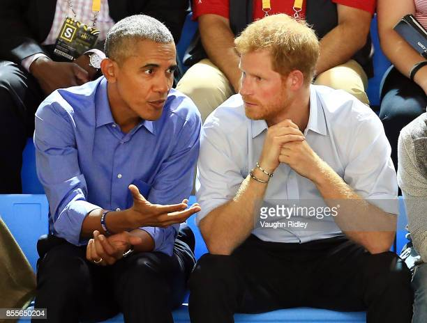 Former US President Barack Obama and Prince Harry chat while watching the Wheelchair Basketball pool match between France and the United States...