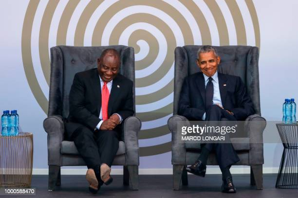 Former US President Barack Obama and South African President Cyril Ramaphosa attend the 2018 Nelson Mandela Annual Lecture at the Wanderers cricket...