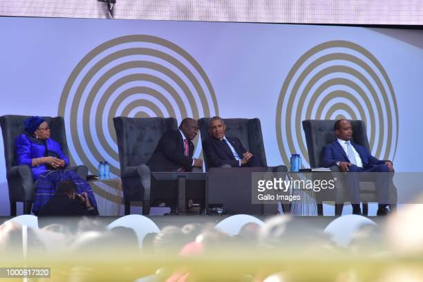 Former US president Barack Obama and South African President Cyril Ramaphosa are flanked by Patrice Motsepe and Graca Machel during the 16th annual...