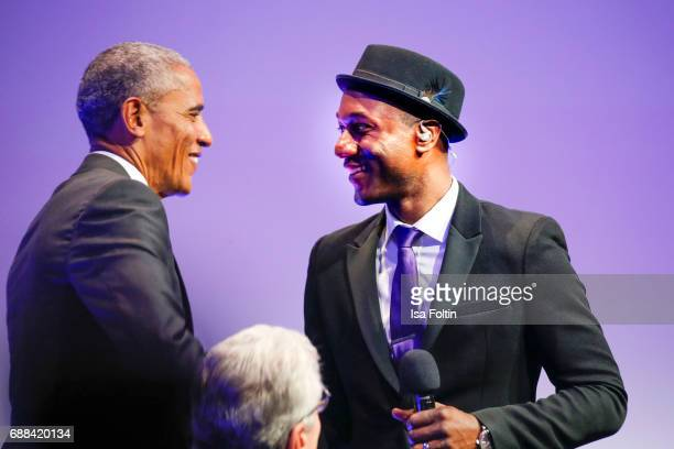 Former US president Barack Obama and the singer of Aloe Blacc during the German Media Award 2016 at Kongresshaus on May 25 2017 in BadenBaden Germany...