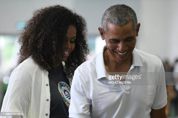 TOPSHOT Former US president Barack Obama and wife Michelle Obama attend a side event for the Obama Foundation in Kuala Lumpur on December 12 2019