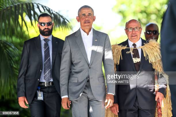 TOPSHOT Former US president Barack Obama arrives for a traditional Maori welcome at Government House in Auckland on March 22 2018 Obama is visiting...
