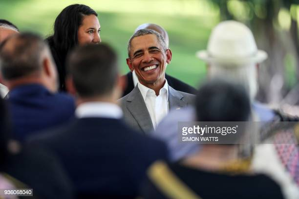 Former US president Barack Obama arrives for a traditional Maori welcome at Government House in Auckland on March 22 2018 Obama is visiting New...