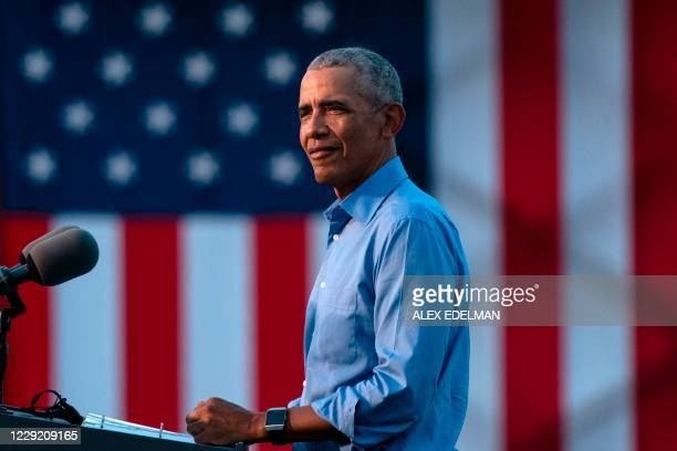Former US President Barack Obama arrives to address Biden-Harris supporters during a drive-in rally in Philadelphia, Pennsylvania on October 21,...