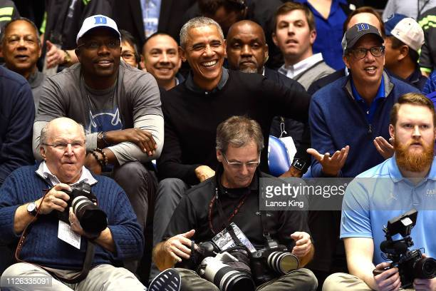 Former US President Barack Obama attends the game between the North Carolina Tar Heels and the Duke Blue Devils in the first half at Cameron Indoor...