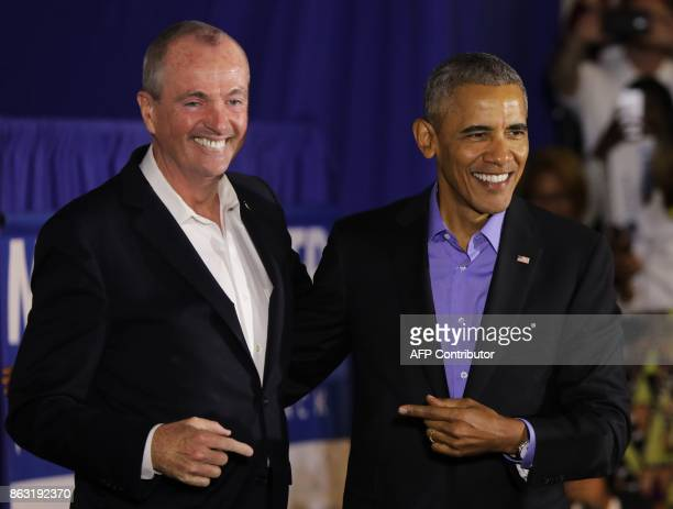 Former US President Barack Obama campaigns for New Jersey Democratic gubernatorial candidate Phil Murphy in Newark New Jersey on October 19 2017 /...