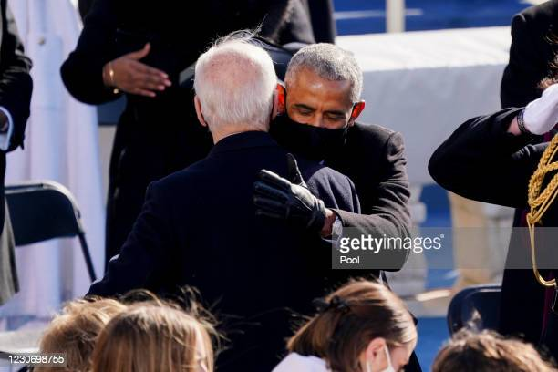 Former U.S. President Barack Obama, center, hugs U.S. President Joe Biden during the inauguration ceremony on the West Front of the U.S. Capitol on...