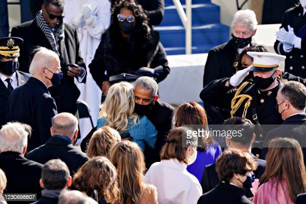 Former U.S. President Barack Obama, center right, hugs First Lady Jill Biden during the inauguration ceremony on the West Front of the U.S. Capitol...