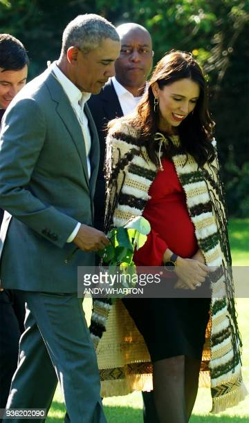 Former US president Barack Obama chats with New Zealand's Prime Minister Jacinda Ardern during his visit to Government House in Auckland on March 22...