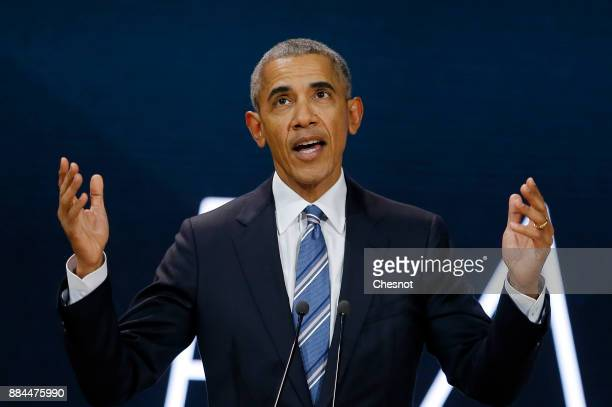 Former US President Barack Obama delivers a speech during the 7th summit of 'Les Napoleons' at Maison de la Radio on December 2 2017 in Paris France...