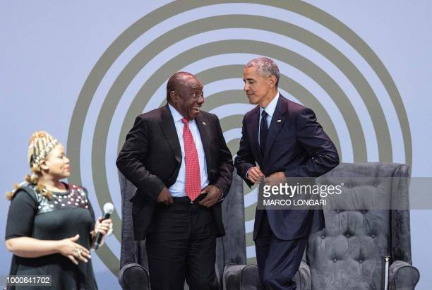 Former US President Barack Obama fastens his vest before dancing on stage with President Cyril Ramaphosa and SouthAfrican singer Thandiswa Mazwai...