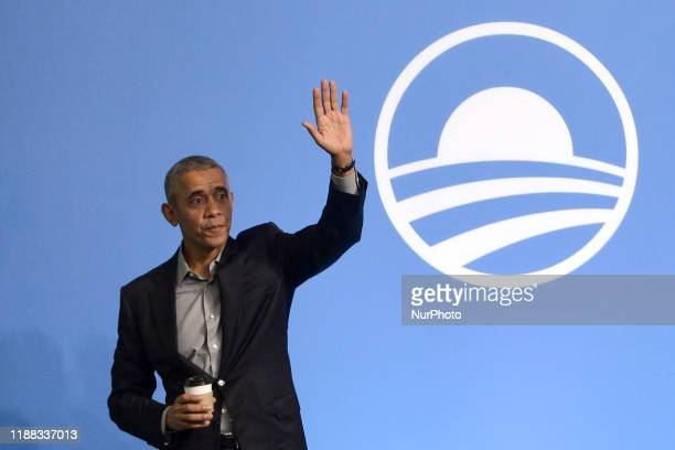 Former US President Barack Obama gesture on the stage as he attends an Obama Foundation event in Kuala Lumpur Malaysia 13 December 2019 Obama and his...