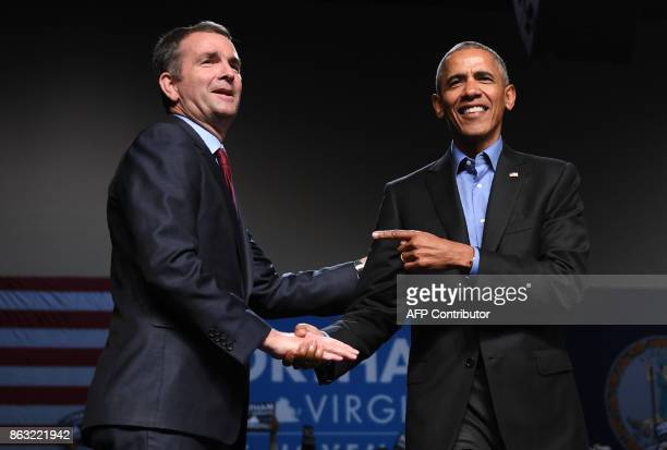 Former US President Barack Obama gestures to Democratic Gubernatorial Candidate Ralph Northam during a campaign rally in Richmond Virginia October 19...