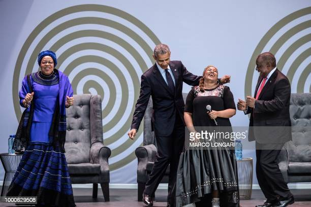 Former US President Barack Obama , Graca Machel , widow of former South African president and global icon Nelson Mandela, and South African President...