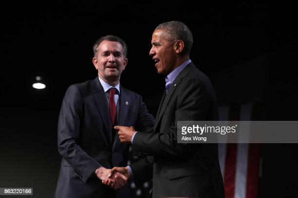 Former US President Barack Obama greets Democratic gubernatorial candidate and Virginia Lieutenant Governor Ralph Northam during a campaign event at...