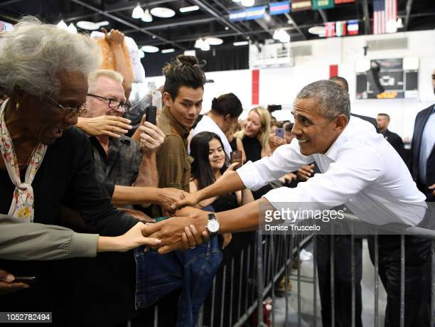 Former US President Barack Obama greets supporters after speaking at a getoutthevote rally at the Cox Pavilion as he campaigns for Nevada Democratic...