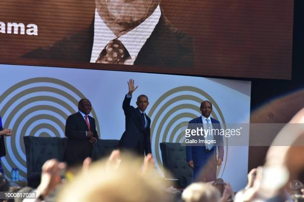 Former US president Barack Obama greets the crowd during the 16th annual Nelson Mandela lecture at Wanderers Stadium on July 17 2018 in Johannesburg...