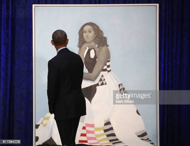 Former US President Barack Obama looks at former first lady Michelle Obama's newly unveiled portrait during a ceremony at the Smithsonian's National...