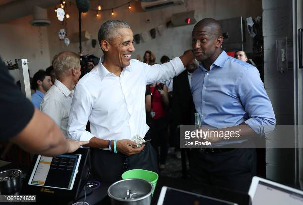 Former US President Barack Obama orders lunch with Florida Democratic gubernatorial candidate Andrew Gillum and US Senator Bill Nelson at the Coyo...