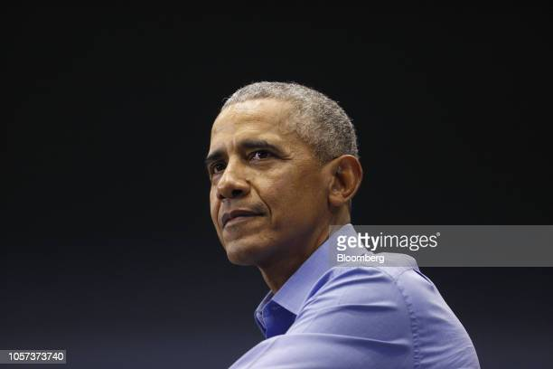Former US President Barack Obama pauses while speaking during a campaign rally with Senator Joe Donnelly a Democrat from Indiana not pictured in Gary...
