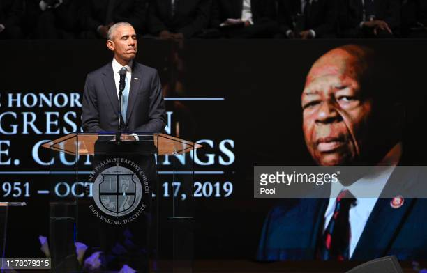 Former US President Barack Obama pauses while speaking during funeral services for late US Representative Elijah Cummings at the New Psalmist Baptist...