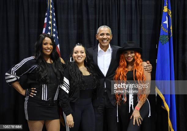 Former US President Barack Obama poses for a photo with musical group SaltNPepa during a getoutthevote rally featuring former US President Barack...