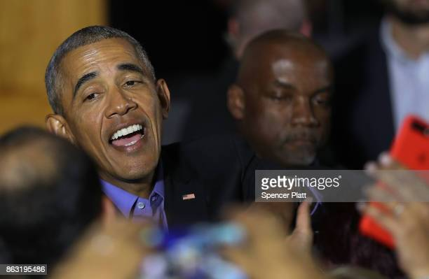 Former US President Barack Obama shakes hands after speaking at a rally in support of Democratic candidate Phil Murphy who is running against...