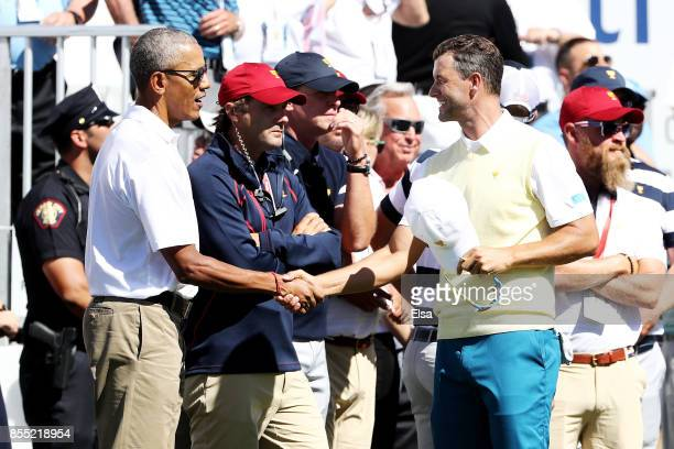 Former US President Barack Obama shakes hands with Adam Scott of Australia and the International Team on the frist tee during Thursday foursome...