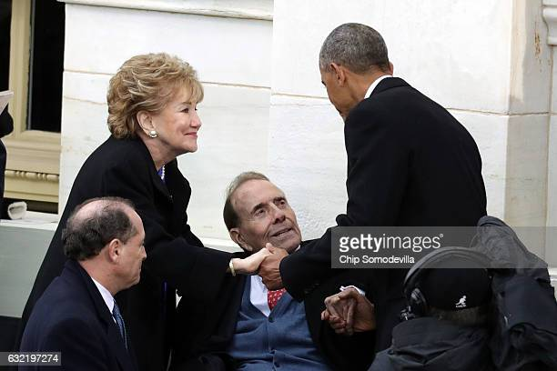 Former US president Barack Obama shakes hands with former Sen Elizabeth Dole and former Sen Bob Dole on the West Front of the US Capitol on January...
