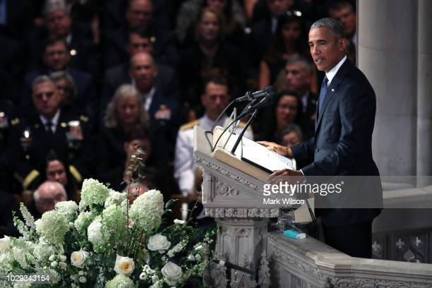 Former US President Barack Obama speaks at the funeral service for US Sen John McCain at the National Cathedral on September 1 2018 in Washington DC...