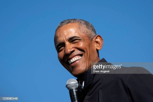 Former U.S. President Barack Obama speaks during a drive-in campaign rally for Democratic presidential nominee Joe Biden at Northwestern High School...