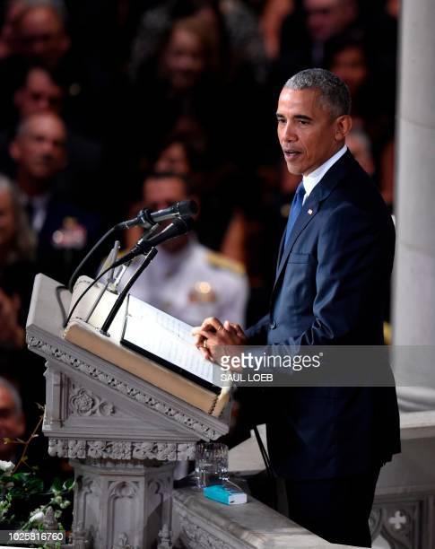 Former US President Barack Obama speaks during a memorial service for US Senator John McCain at the Washington National Cathedral in Washington DC on...