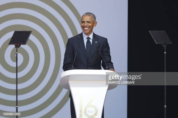 Former US President Barack Obama speaks during the 2018 Nelson Mandela Annual Lecture at the Wanderers cricket stadium in Johannesburg on July 17...