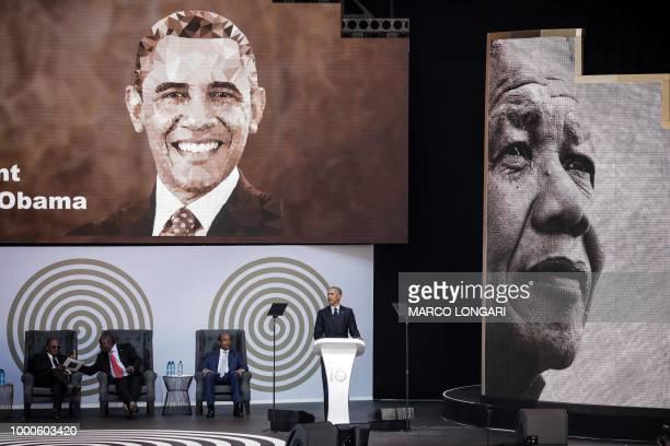 Former US President Barack Obama speaks next to the Chancellor of the University of Johannesburg Professor Njabulo Ndebele South African President...