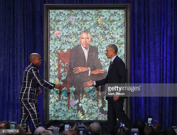 Former U.S. President Barack Obama stands artist Kehinde Wiley next to his newly unveiled portrait during a ceremony at the Smithsonian's National...