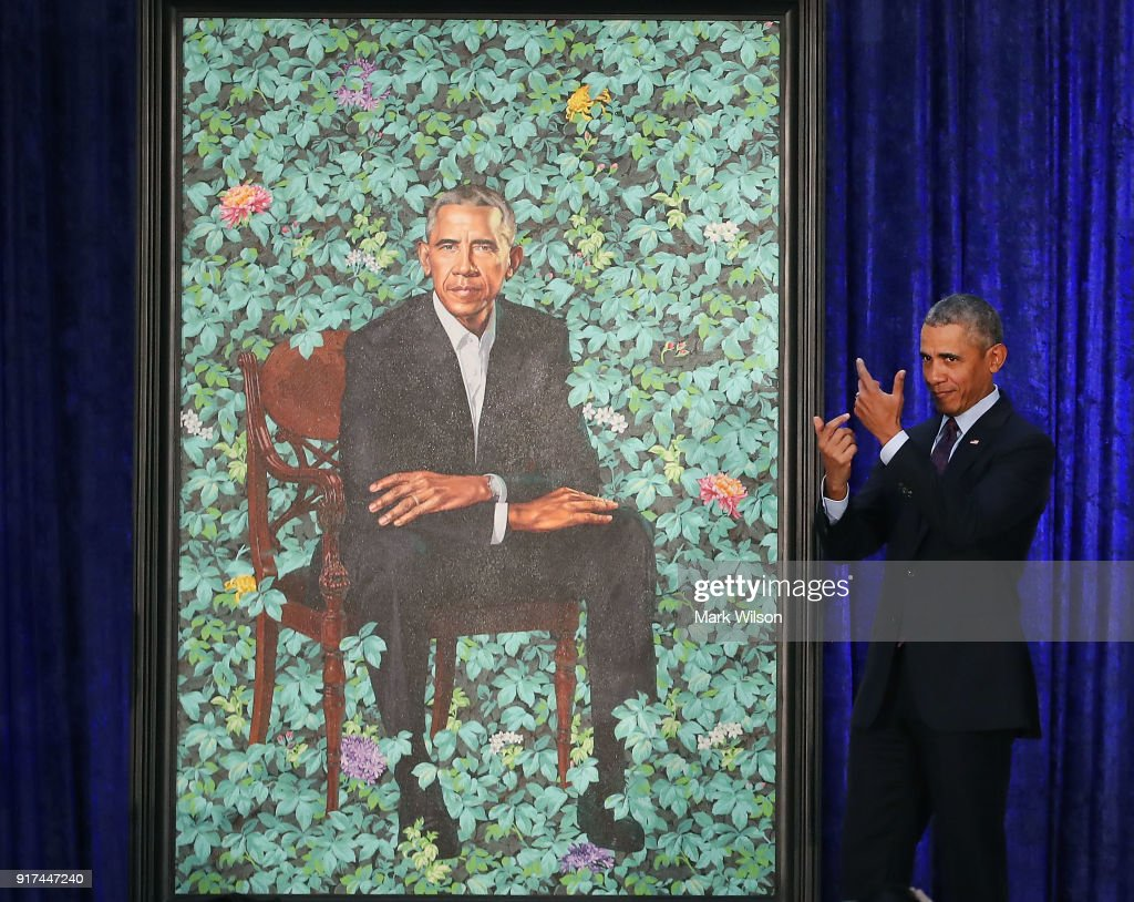 Former U.S. President Barack Obama stands next to his newly unveiled portrait during a ceremony at the Smithsonian's National Portrait Gallery, on February 12, 2018 in Washington, DC. The portraits were commissioned by the Gallery, for Kehinde Wiley to create President Obama's portrait, and Amy Sherald that of Michelle Obama.