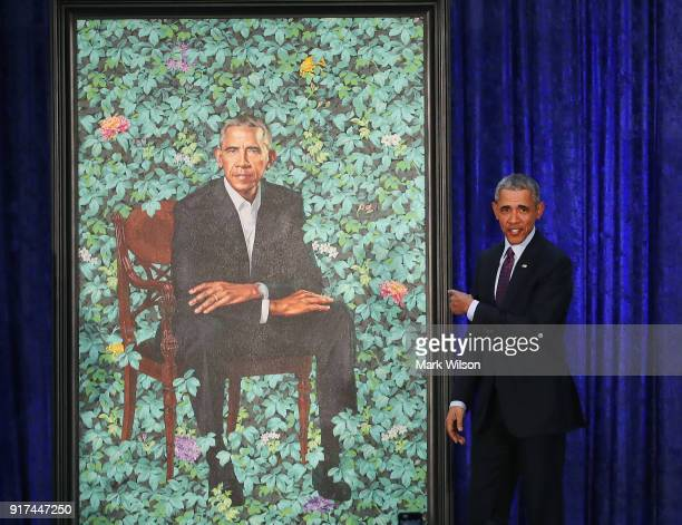 Former U.S. President Barack Obama stands next to his newly unveiled portrait during a ceremony at the Smithsonian's National Portrait Gallery, on...