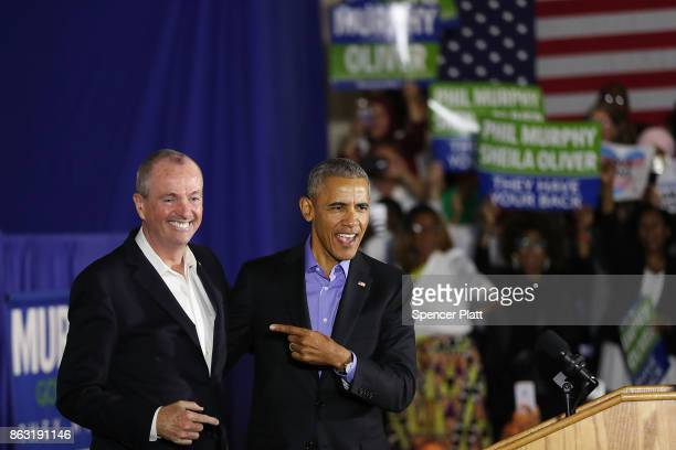 Former US President Barack Obama stands on stage with Democratic candidate Phil Murphy who is running against Republican Lt Gov Kim Guadagno for the...
